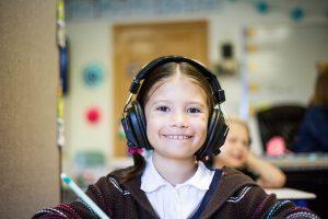 Schoolchild with Earphones - Families as Allies