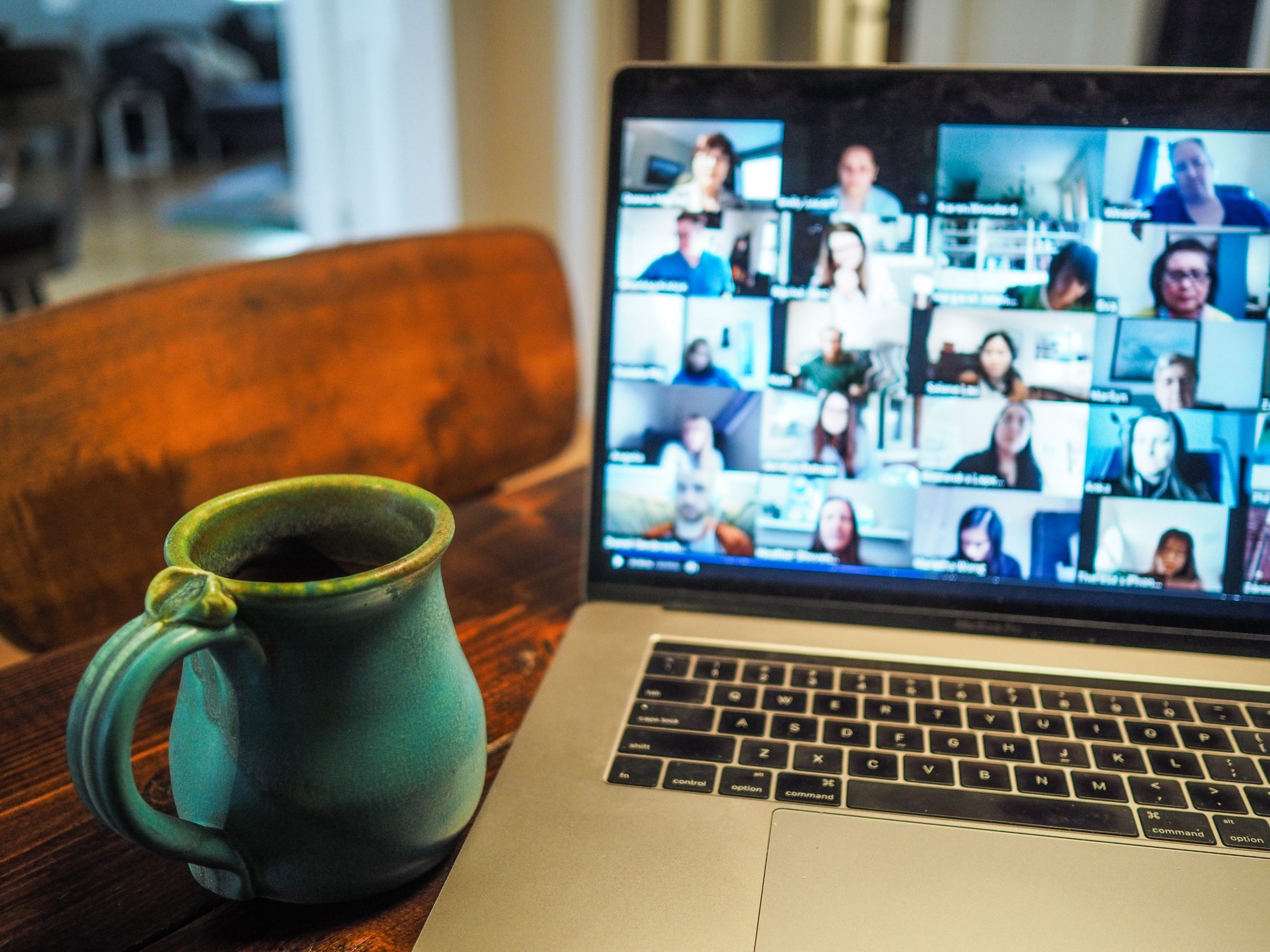 a coffee cup sits in front of an open laptop